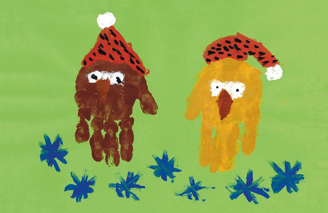 zwei Eulen mit Weihnachtsmütze