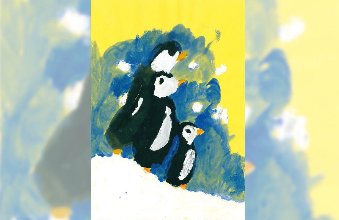 Ein Pinguinfamilie im Schnee